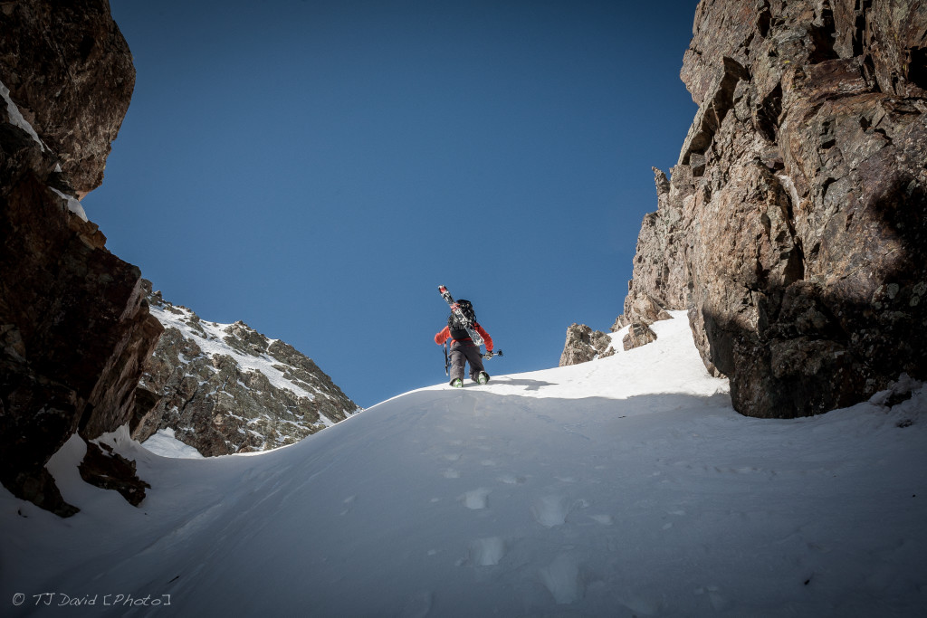 Adam reaching the top of the couloir.